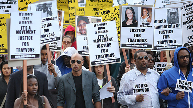 People walk in a silent protest march in Los Angeles to demand justice for the shooting of Trayvon Martin.