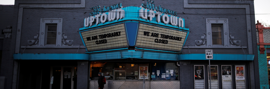 "cinema marquee that reads ""We Are Temporarily Closed"""