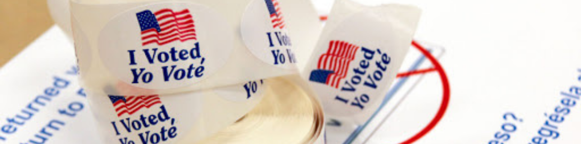 "Roll of round white stickers that read ""I Voted, Yo Vote"" with the U.S. flag"