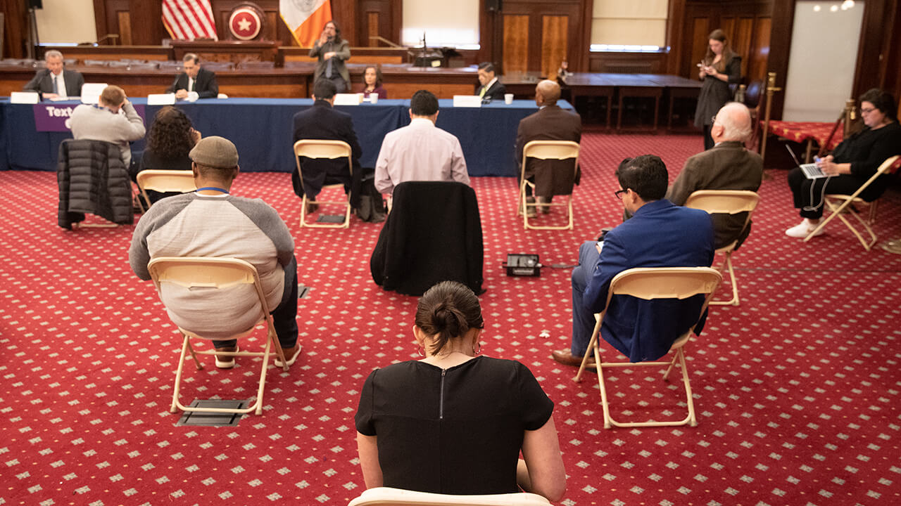 Reporters keep a six-foot distance during a news conference for the outbreak of Coronavirus disease (COVID-19) at City Hall in the Manhattan borough of New York City, New York
