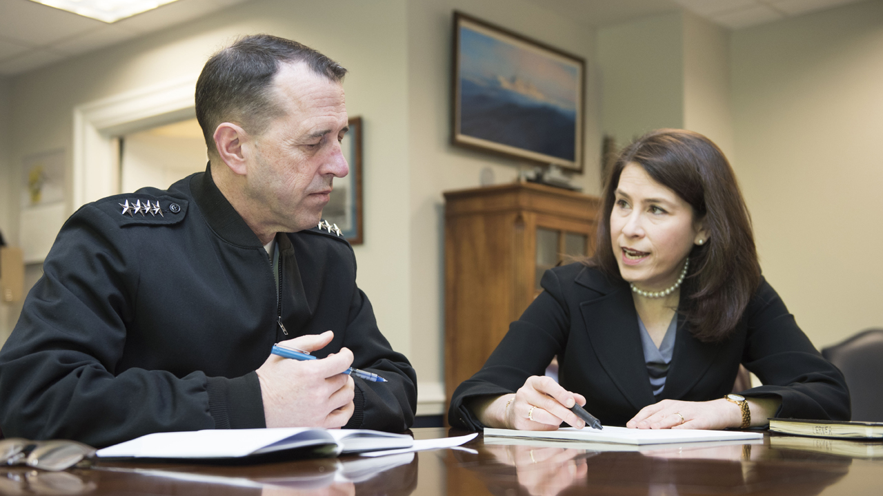 Jennifer Lerner sits with Navy Admiral John Richardson in a meeting at the Pentagon.