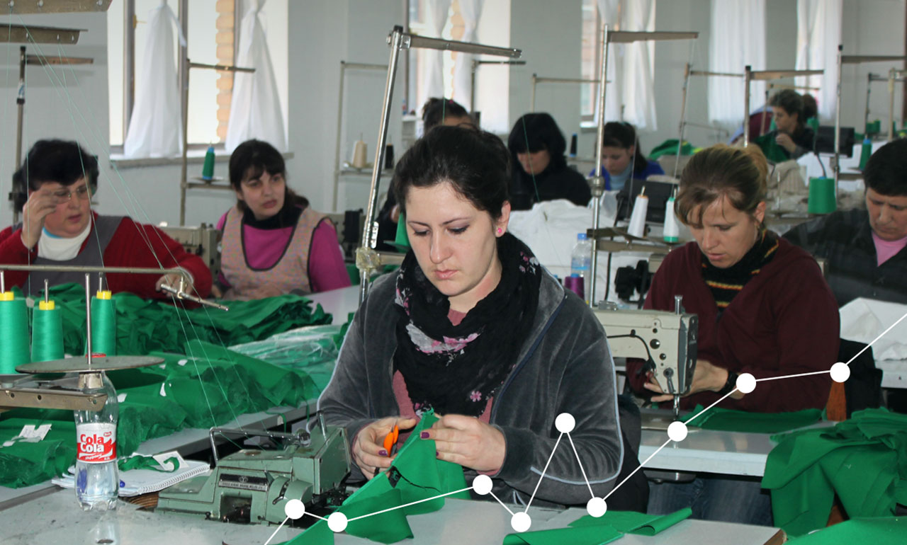 An image of Albanian textile workers busy at sewing stations.