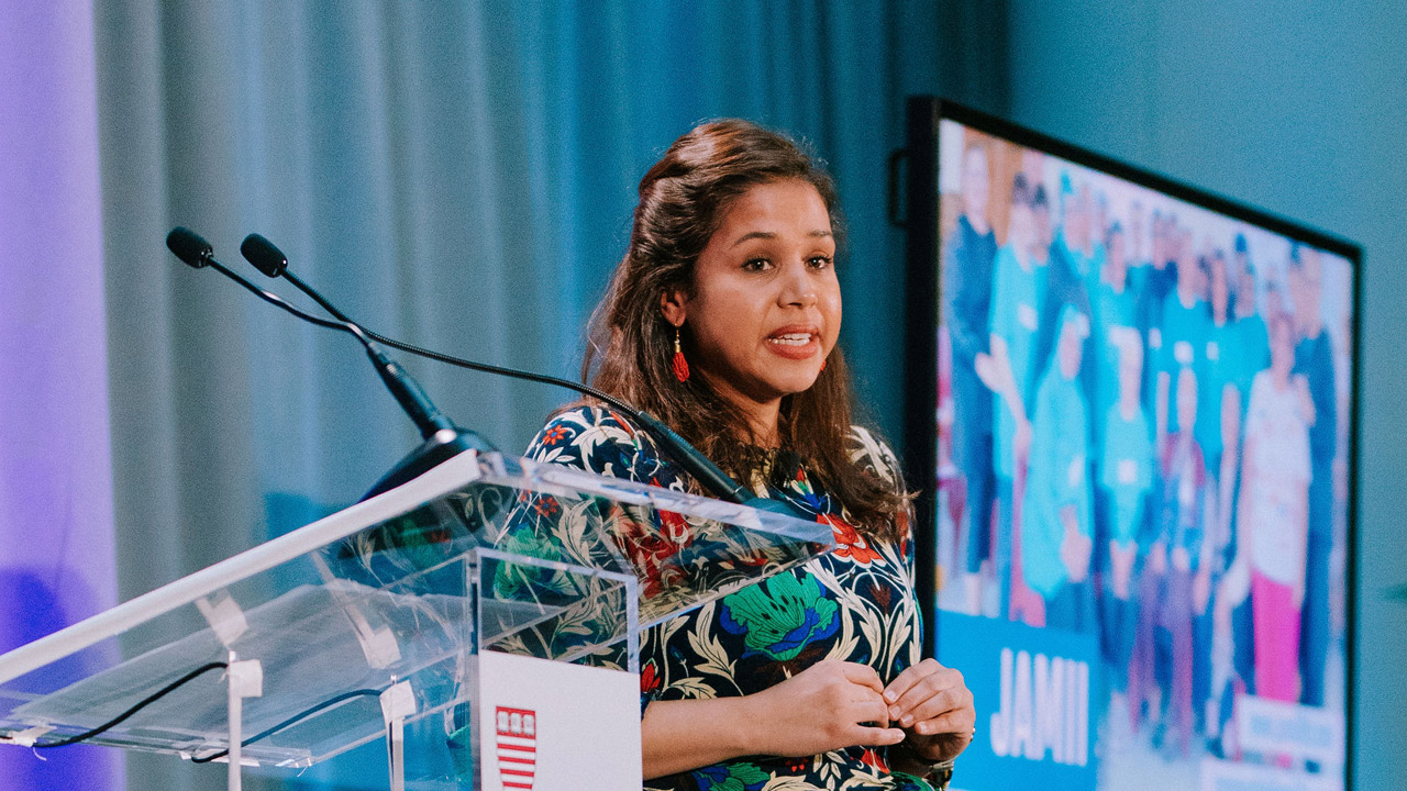 Portrait of Harvard Kennedy School graduate Zeenith Ebrahim speaking at the 2019 Social Innovator Showcase.