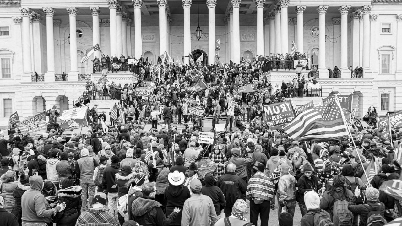 A mob of pro-Trump extremists masses around the Capitol.