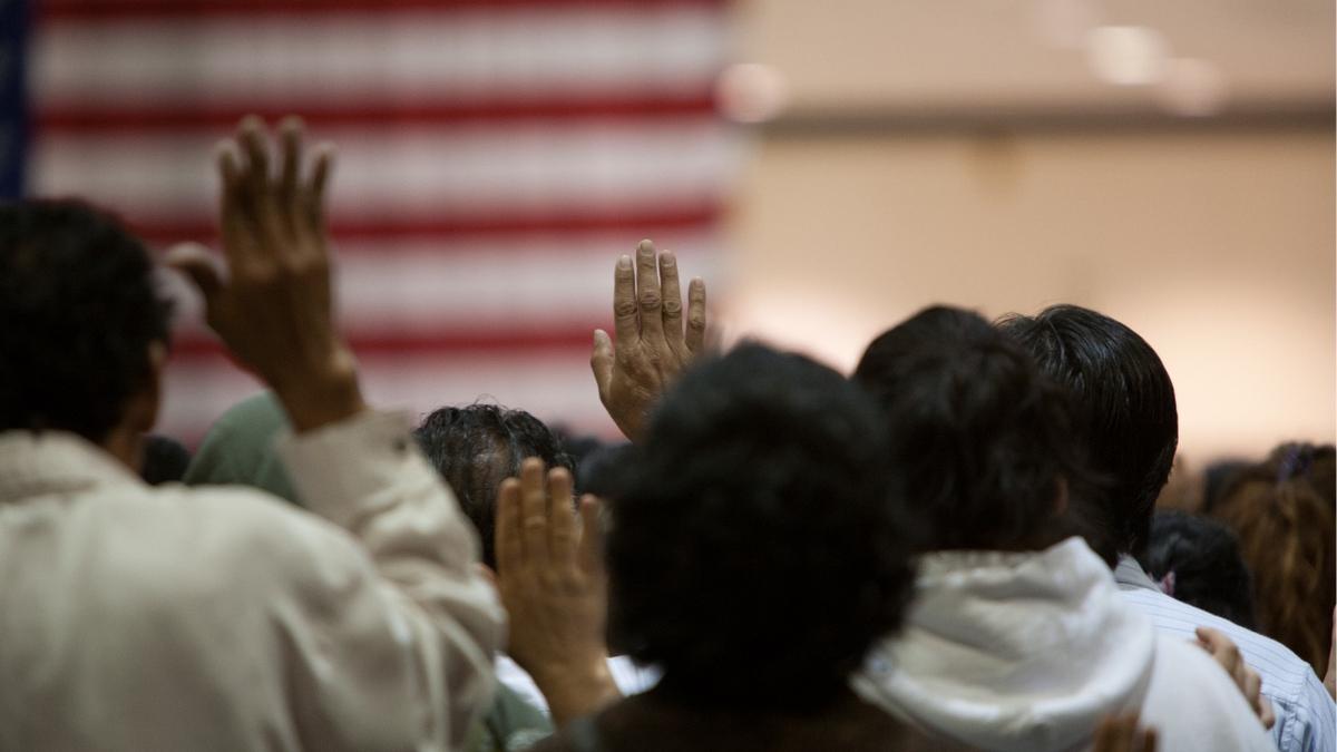 Raising hands.