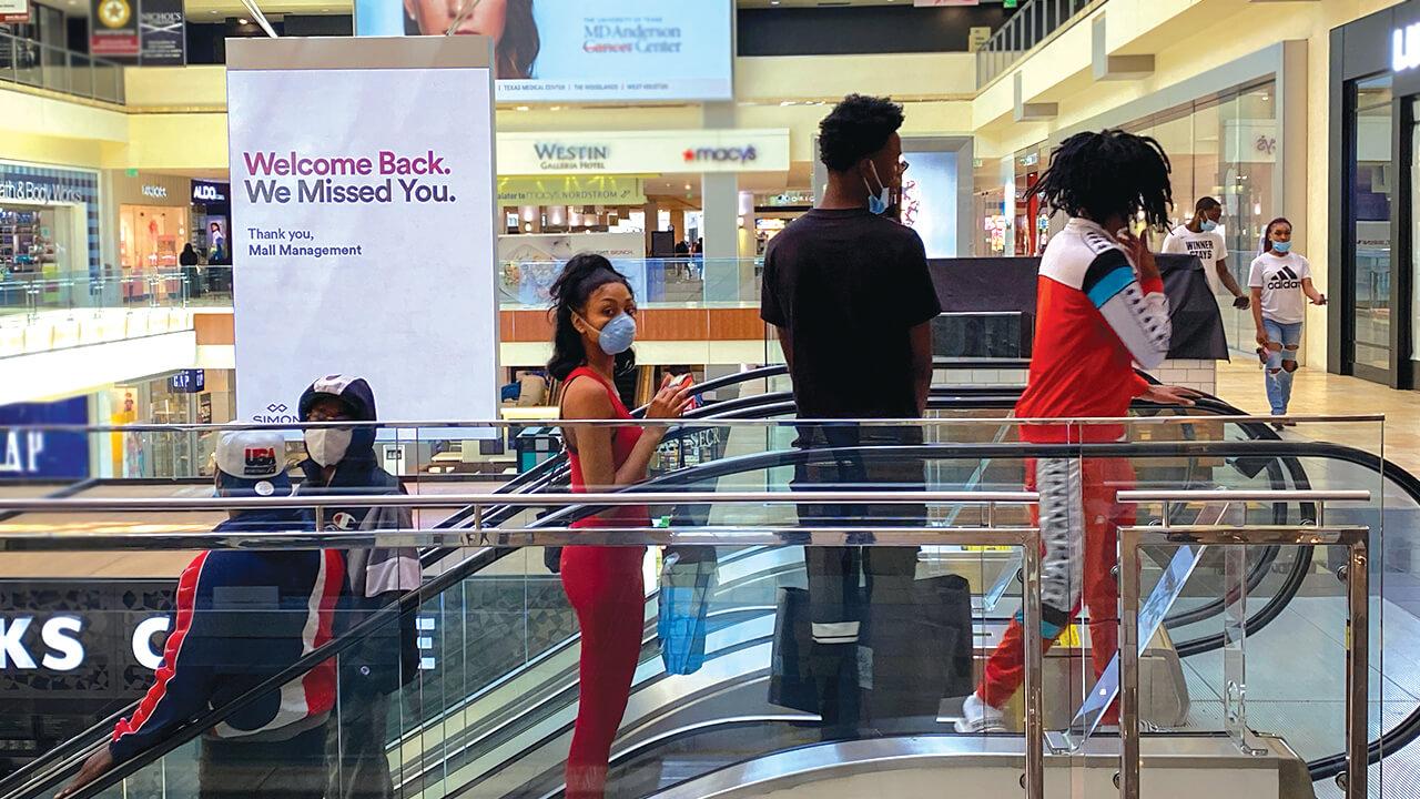 Shoppers wear masks in mall.